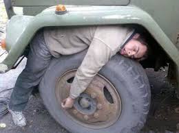 Man sleeping in tire
