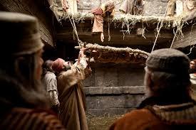 Man lowered Before Jesus