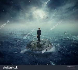 Man On Rock in Ocean